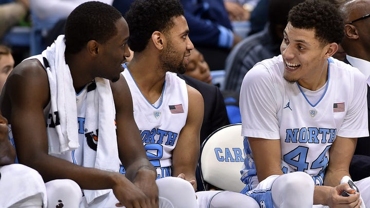 North Carolina Tar Heels forward Isaiah Hicks (4) and guard Joel Berry II (2) and forward Justin Jackson (44) react during game against the Appalachian State Mountaineers during the second half at Dean E. Smith Center. The Tar Heels won 94-70.
