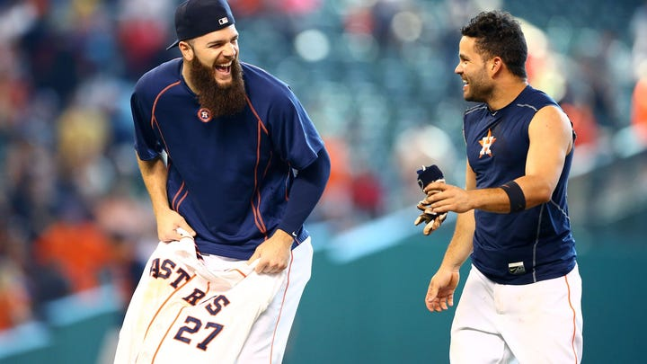 Aug 16, 2015; Houston, TX, USA; Houston Astros second baseman Jose Altuve (right) celebrates with pitcher Dallas Keuchel after hitting a walk off single against the Detroit Tigers at Minute Maid Park. The Astros defeated the Tigers 6-5.