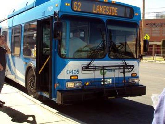 Bus riders boarded a Sun Metro bus in front of University Medical Center in South-Central El Paso Friday. Diana Washington Valez/El Paso Times