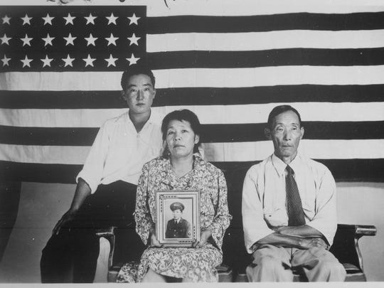 The Hirano family is photographed in 1942 at the Colorado River Relocations Center in Poston, Arizona.