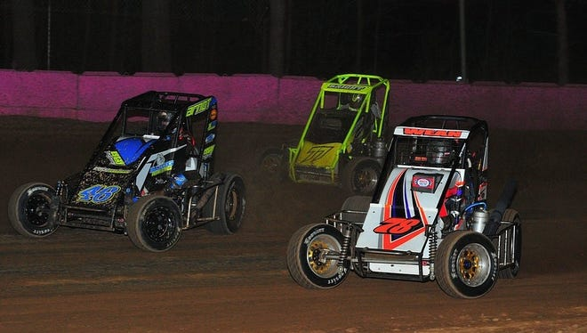 The ARDC Midgets race at Linda's went three-wide for the lead. Eventual winner Brett Arndt, left, races Alex Bright, center, and Nick Wean.