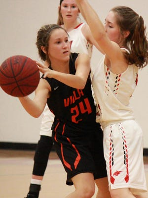 Viola's Ryhlea Castaneda is guarded by Flippin's Katelynn Hicks on Tuesday night at Bobcat Country.