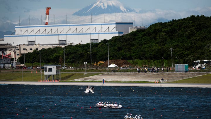 Rowers prepare for a test run at the Sea Forest Waterway, a venue for rowing at the Tokyo 2020 Olympics, as Mount Fuji is visible in the distance Sunday, June 16, 2019, in Tokyo. (AP Photo/Jae C. Hong)