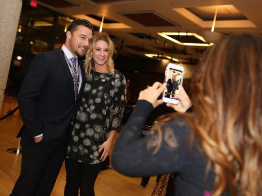 Chris Soules takes a photo with Shannon Salmon during the Raucous Before the Caucus event on Saturday, January 30, 2016 at the State Historical Building in Des Moines.