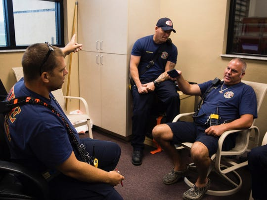 Captain Jason Sellers relays information about communication after the storm hits with Paul Pernak and Thomas Easley at the Greater Naples Fire Rescue Station 72 on Sunday, September 10, 2017 as Hurricane Irma nears Marco Island.