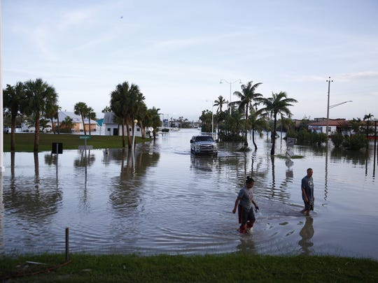 Arron Barlett and Sally Osceola live in the Estuary apartments complex in Everglades City on the second floor wading around in flood water on Sept.. 11, 2017.