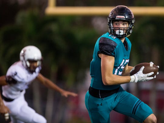 Gulf Coast High School wide receiver Tobey Mcdonough runs with the ball at Golden Gate High School in Naples where the Sharks took on the Riverdale Raiders on Thursday, September 28, 2017.