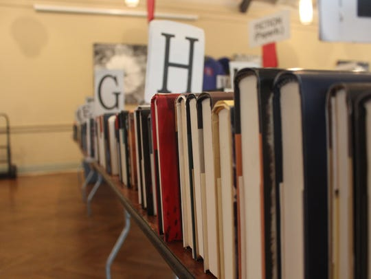 A section of books sit out on Saturday. There were