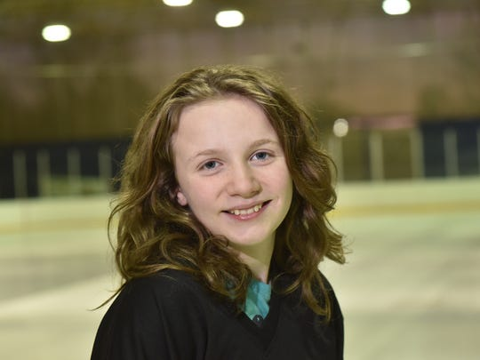 Emma Voorhis, 12, at Mackay Ice rink in Englewood on Feb. 20, 2018, the day before the U.S. women's hockey team takes on Canada for the Olympic gold medal. Voorhis, a hockey player, and her teammates will be cheering on Team USA. Twenty years ago, 1998, was the historic showdown between the U.S. and Canada: it wasthe final battle of the first women's hockey tournament at the Winter Games.