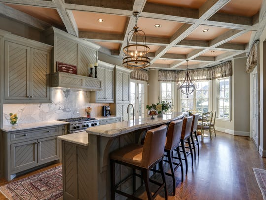 The kitchen at 9265 Carrisbrook flows into the dining