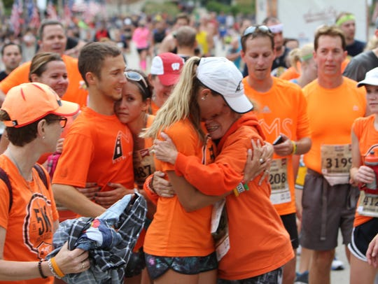 Ashley Schneider hugs her mom, Jill Kumlien, during a past MS Run The US event.