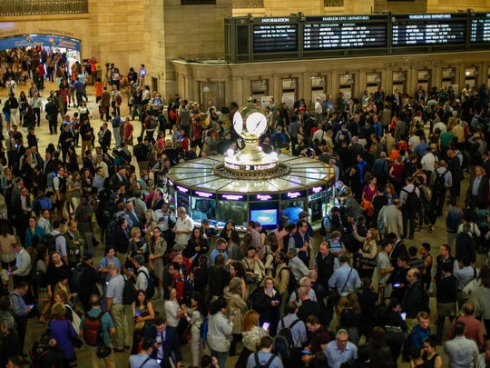 NEW YORK, NY - MAY 15: Commuters wait for train service