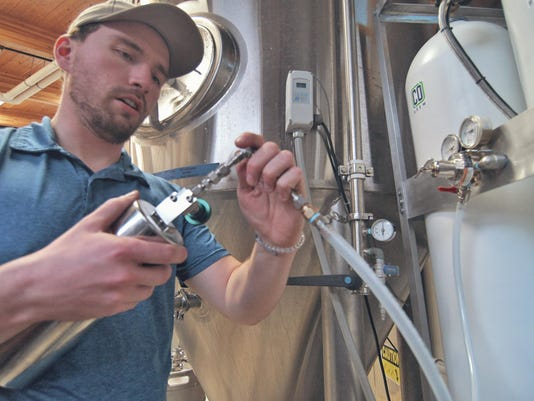 Taylor-Woods-conducting-CO2-purity-tests-on-Lolo-Peak-Brewing-Company-s-system-picture-by-Tresha-Sanders-.jpg
