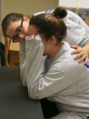 """An emotional Samantha Clegg gets consoled by friend and fellow cadet Tori Burton. Clegg had to stop working for a few minutes as she became overwhelmed with the thought of graduating from the Bluegrass ChalleNGe Academy while helping clean a former elementary school at Fort Knox. """"She's helped me through stuff,"""" said Burton."""