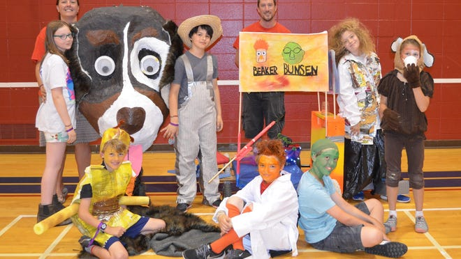 Members of Germantown Odyssey of the Mind team. Back Row: Coaches Kim and Nathan Bowles. Middle Row: Margot Sher, Theo Weiss, Finnegan Peterson, Leah Papp. Front Row: Jackson Bowles, Connor Phelan, Dylan Bowles.