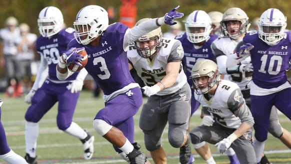 New Rochelle's Myles Taylor (3) looks for some running