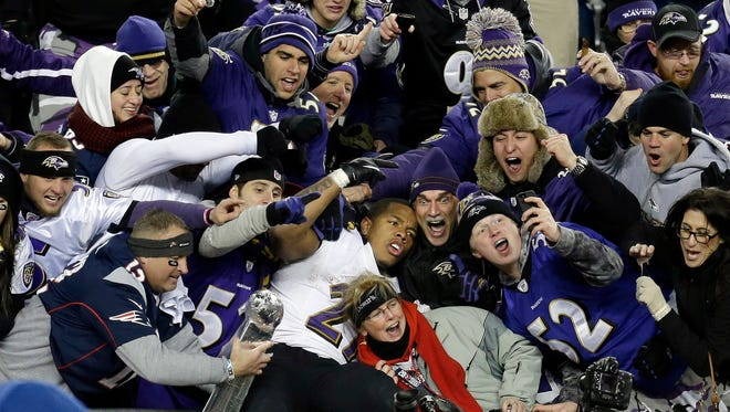 Ravens running back Ray Rice, center, is surrounded by fans in the stands as he celebrates winning the AFC Championship game on Jan. 20, 2013.