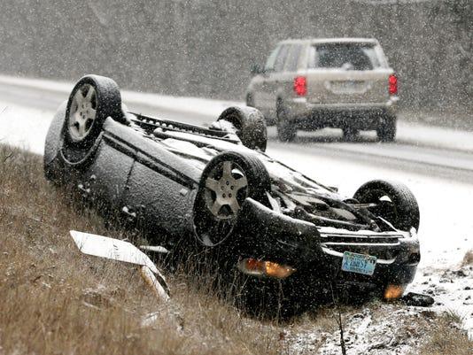 OVERTURNED CAR, SNOW