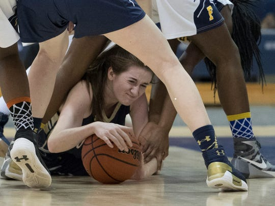 Noelle Gonzalez fights for a loose ball on floor and throws it out to a teammate during first half action. NV/Old Tappan vs Franklin Girls Basketball in NJSIAA quarterfinal game at Toms River on March 14, 2018