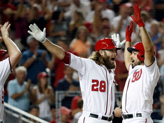 Washington Nationals' Anthony Rendon, right, celebrates his grand slam with Jayson Werth (28) during the third inning of a baseball game against the Atlanta Braves at Nationals Park, Tuesday, Sept. 6, 2016, in Washington. (AP Photo/Alex Brandon)