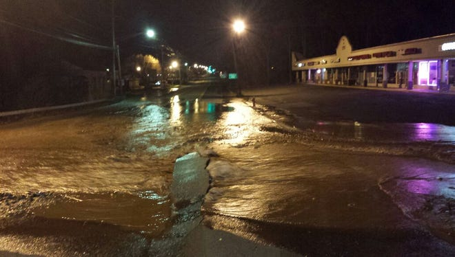 A river of water after a water main break on Route 59 near North Airmont Road in Airmont, April 24, 2015. The break closed Route 59 for more than four hours.