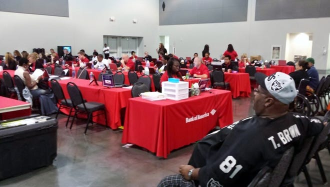 Homeowners wait to meet with Bank of America representatives during a recent Neighborhood Assistance Corp. of America event in hopes of modifying their mortgage to an affordable payment.