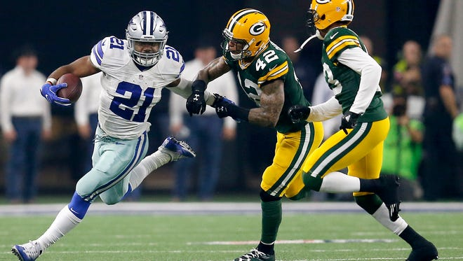 Cowboys running back Ezekiel Elliott runs past Packers safety Morgan Burnett during their divisional playoff game in last January.