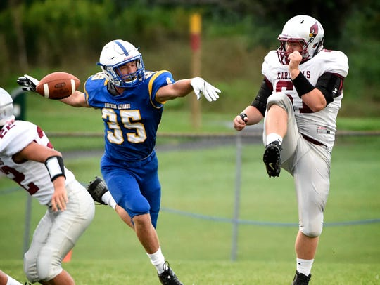 Viking Blaise Bressler helps to block a punt early