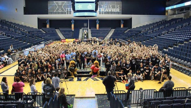 Over 700 high school students gathered in the Cintas Center at Saint Xavier University to raise money for pediatric cancer research Saturday evening.