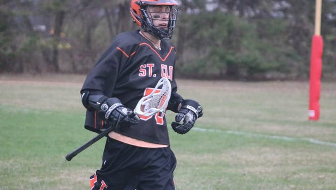 St. Cloud Tech/Apollo/Cathedral boys lacrosse player Cade Anderson participates in a recent game. The junior striker has had to put his career on hold because of cancer.