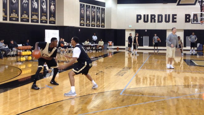 New Purdue guard Jon Octeus (left) gets in work during his first Boilers practice.
