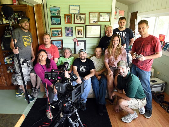 The cast and crew of Poor Mama's Boy takes a break from filming for a group photograph. Director Dalton Coffey wrote the script with Yellville in mind and plans to shop the independent movie around at different film festivals.
