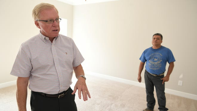David McGowan, owner of Regent Homes, left,  and Jose Dejesus Lara Rangel, owner of One Man One Brush, walk through a new Regent home under where Rangel's company was the painting contractor. Wages have gone up significantly but they still can't find adequate supply of workers. GOBuild Tennessee is an initiative McGowan and other builders have been promoting to get more young people in the sector.