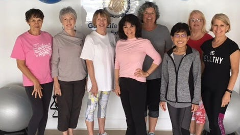 GoodLife Fitness owner and instructor Peggy Hamilton, CPT, LMT, center, with some of the Friends in Motion participants.