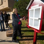 S.S. Dixon Intermediate School Principal Linda Gooch dedicates a new little public library in Pace Monday afternoon. The little public library box is located at the Benny Russell Park off West Spencer Field Road.