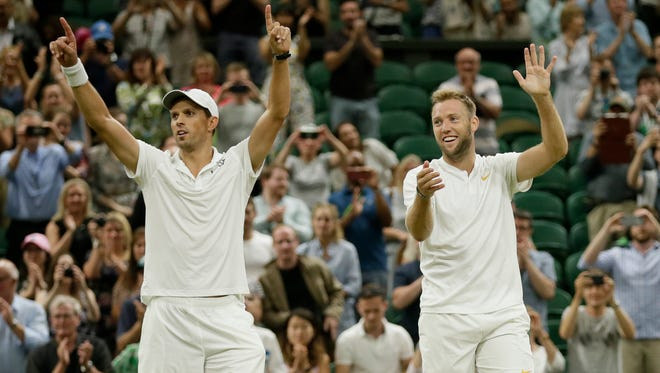 Camarillo's Mike Bryan and Jack Sock, right, celebrate winning their men's doubles final match against South Africa's Raven Klaasen and New Zealand's Michael Venus at Wimbledon on Saturday.