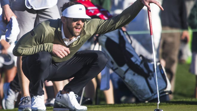 Michael Phelps looks at his putt on the 10th hole during the Annexus Pro-Am at the 2018 Waste Management Phoenix Open at TPC Scottsdale, Wednesday, January 31, 2018.