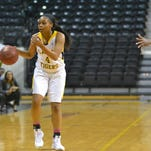 Grambling's Monisha Neal brings the ball up court against the Alcorn State defense.