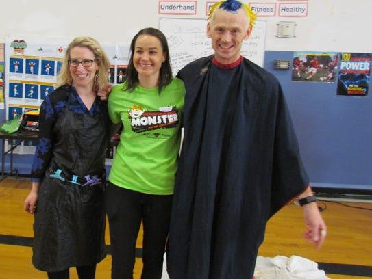 Honorary hair stylist Becky Toquiero, left, Katie Singer,