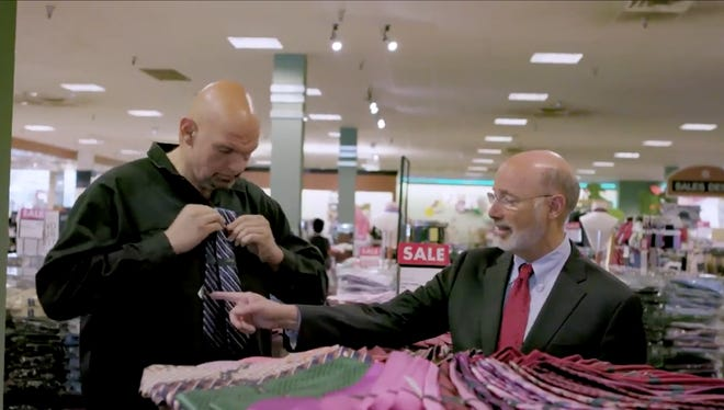 In a campaign video, Gov. Tom Wolf is seen helping his running mate buy a tie.