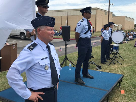 "Retired Col. Steve Shinkle takes in the student-run ""Pass 'N Review"" military parade the Cooper High School Air Force Junior ROTC staged Wednesday to mark the end of formal school events on Wednesday."