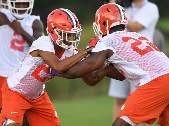 Clemson defensive back Kyler McMichael (21), left, and defensive end Xavier Kelly (22) during the Tigers opening day of practice on Friday, August 3, 2018.