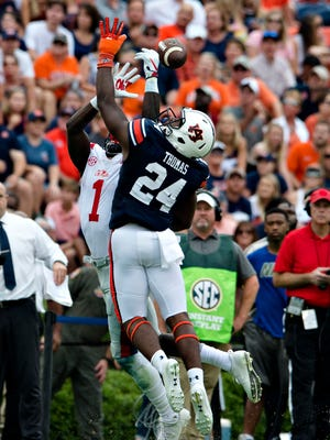 Auburn defensive back Daniel Thomas (24) deflects a pass intended for Ole Miss wide receiver A.J. Brown (1) during the NCAA football game between Auburn and Ole Miss on Saturday, Oct. 7, 2017, in Auburn, Ala.
