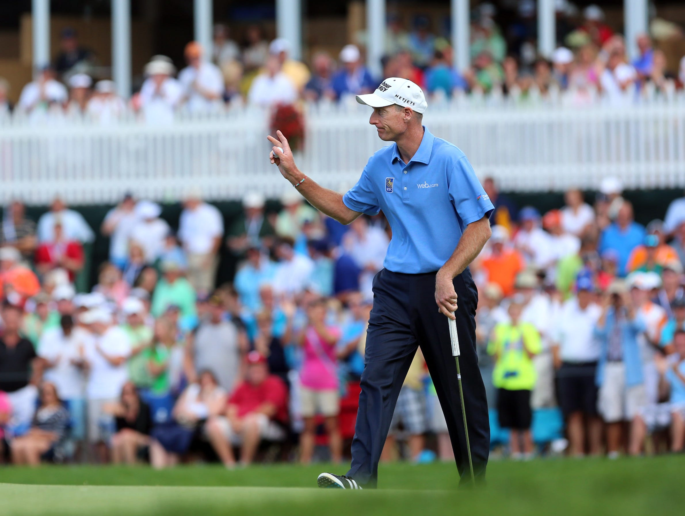Jim Furyk waves to the gallery at No. 6.