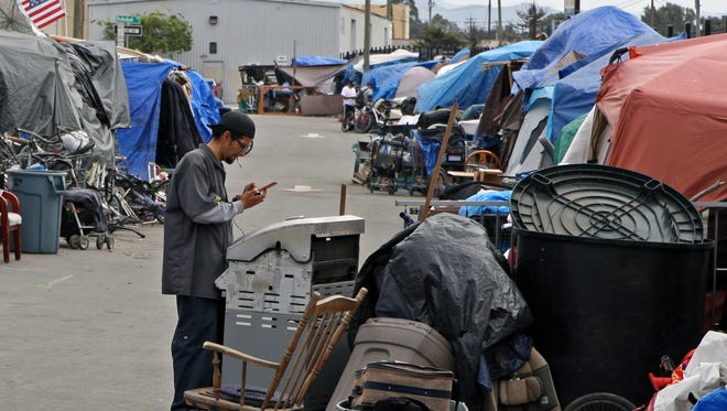 FILE -- Homeless encampment along Lake Street