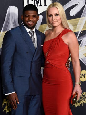 Predators defenseman P.K. Subban and his girlfriend, Olympic gold medalist skier Lindsey Vonn, on the red carpet at the 2018 CMT Awards on June 6.