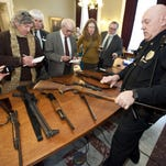 Captitol Police Chief Les Dimick shows a selection of long guns at the Statehouse on Feb. 1, 2013. The guns included shotguns, bolt-action and leve-action hunting rifles and semi-automatics.