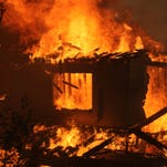 A house is consumed by a wildfire May 14, 2014 in San Marcos, California. About 500 acres have burned in the San Marcos blaze, fueled by record heat, high winds and dry conditions. At least four other fires advanced in nearby communities.
