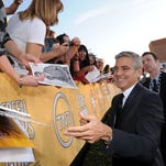 George Clooney got up close to the fan bleachers near the red carpet at the 18th SAG Awards in January 2012.