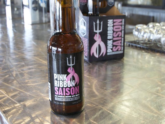 A portion of the proceeds from Triton Brewing's Pink Ribbon Saison benefit local and national cancer charities.